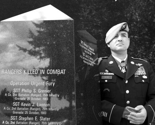 Leroy Petry standing next to Leroy Monument